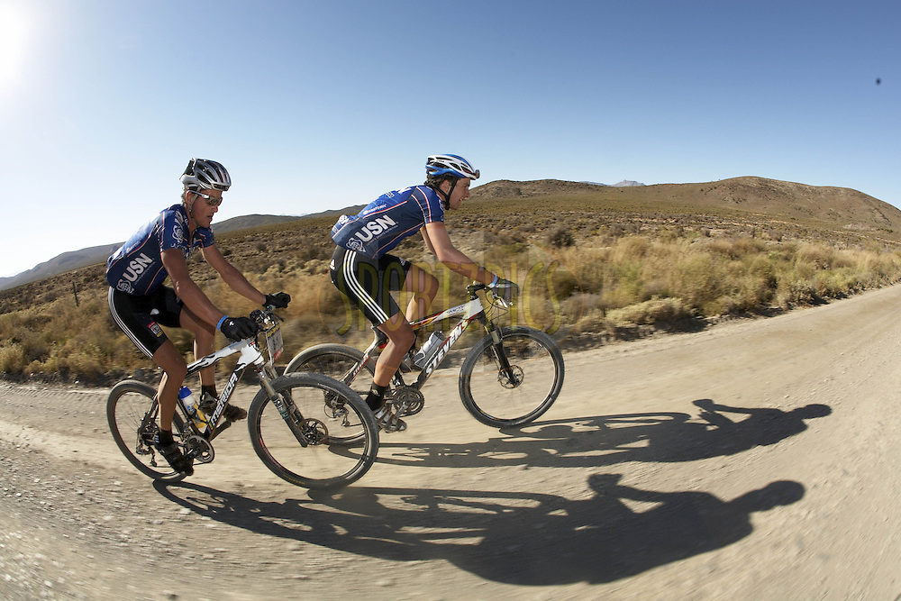 WESTERN CAPE, SOUTH AFRICA -  31 March 2008, Max Knox and Brandon Stewart of USN broke away through the Klein Karoo during stage three of the 2008 Absa Cape Epic Mountain Bike stage race from Calitzdorp Spa.to Langenhoven High School in Riversdale, Western Cape, South Africa..Photo by Gary Perkin/SPORTZPICS