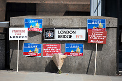 © Licensed to London News Pictures. 03/06/2018. London, UK. Placards are placed on London Bridge to mark one year since the London Bridge and Borough Market terror attacks. A series of events have taken place throughout the day, including a service of commemoration at Southwark Cathedral, the planting of an olive tree in the Cathedral grounds, a minute's silence at 4:30pm and the laying of flowers.  Photo credit : Tom Nicholson/LNP