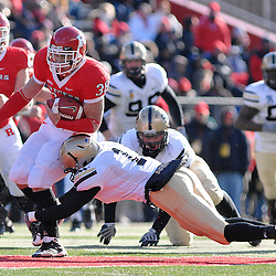 Nov. 22, 2008; Piscataway, NJ, USA; Rutgers running back Joe Martinek (38) is tackled by Army's Nicholas Sabellico (1) during the second quarter of the Rutgers' 30-3 victory over Army at Rutgers Stadium.