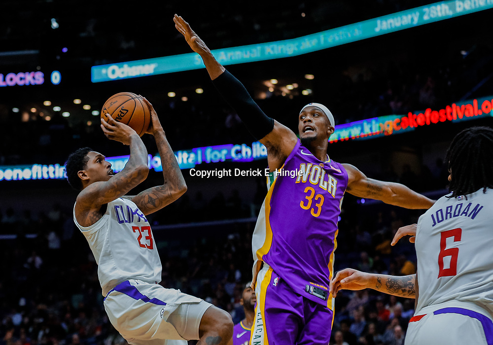 Jan 28, 2018; New Orleans, LA, USA; LA Clippers guard Lou Williams (23) shoots over New Orleans Pelicans forward Dante Cunningham (33) during the first quarter at the Smoothie King Center. Mandatory Credit: Derick E. Hingle-USA TODAY Sports