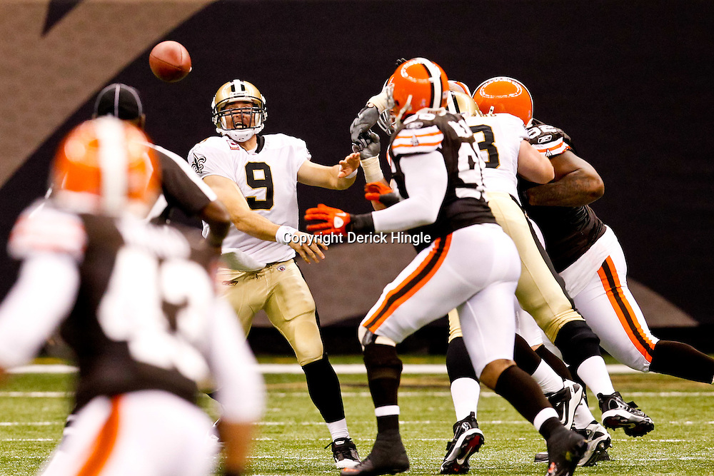 Oct 24, 2010; New Orleans, LA, USA; New Orleans Saints quarterback Drew Brees (9) throws an interception to Cleveland Browns linebacker David Bowens (96) during the first half at the Louisiana Superdome. Mandatory Credit: Derick E. Hingle