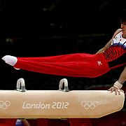 A Japanese gymnast performing on the pommel horse during the Men's Artistic Gymnastics podium training at North Greenwich Arena during the London 2012 Olympic games preparation at the London Olympics. London, UK. 25th July 2012. Photo Tim Clayton