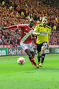 Alan Judge beats Albert Adomah to the ball during the Sky Bet Championship Play Off Second Leg match between Middlesbrough and Brentford at the Riverside Stadium, Middlesbrough, England on 15 May 2015. Photo by Simon Davies.