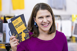 "© Licensed to London News Pictures . 14/09/2019. Bournemouth, UK. Party leader JO SWINSON holds up a signed copy of the Lib Dem manifesto with "" Bollocks to Brexit on the front cover "" during a tour of the exhibition at the conference . The first day of the Liberal Democrat Party Conference in Bournemouth . Photo credit: Joel Goodman/LNP"