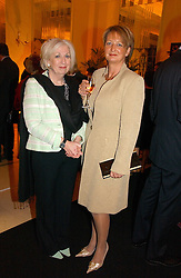 Left to right, MOIRA COLLINS and EDWINA DUNN co-founder and Chief Executive of dunnhumby ltd a finalist of the 2006 Veuve Clicquot Award  at a reception for the winners of the 2006 Veuve Clicquot Award - Business Woman of the Year held at Claridge's Hotel, brook Street, London on 27th April 2006.  This years winner was Vivienne Cox, BP CEO for Gas, Power, Renewables and Integrated Supply & Trading.  The awards were presented by the Rt.Hon.Gordon Brown MP - The Chancellor of the Exchequer.<br />
