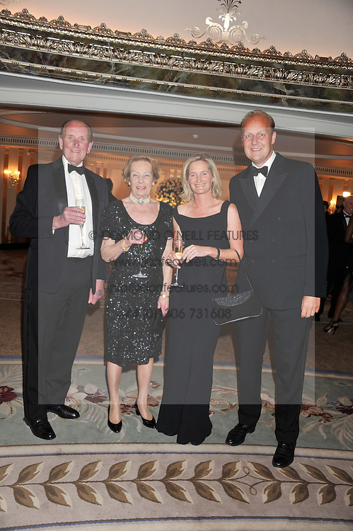 Left to right, MR & MRS JOHN DUNLOP and MR & MRS EDWARD DUNLOP at the 21st Cartier Racing Awards held at The Dorchester, Park Lane, London on 15th November 2011.