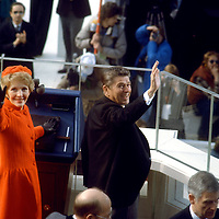 President Ronald Reagan and Nancy Reagan wave from the podium at the 1981 Presidential Inauguration in Washington, DC.
