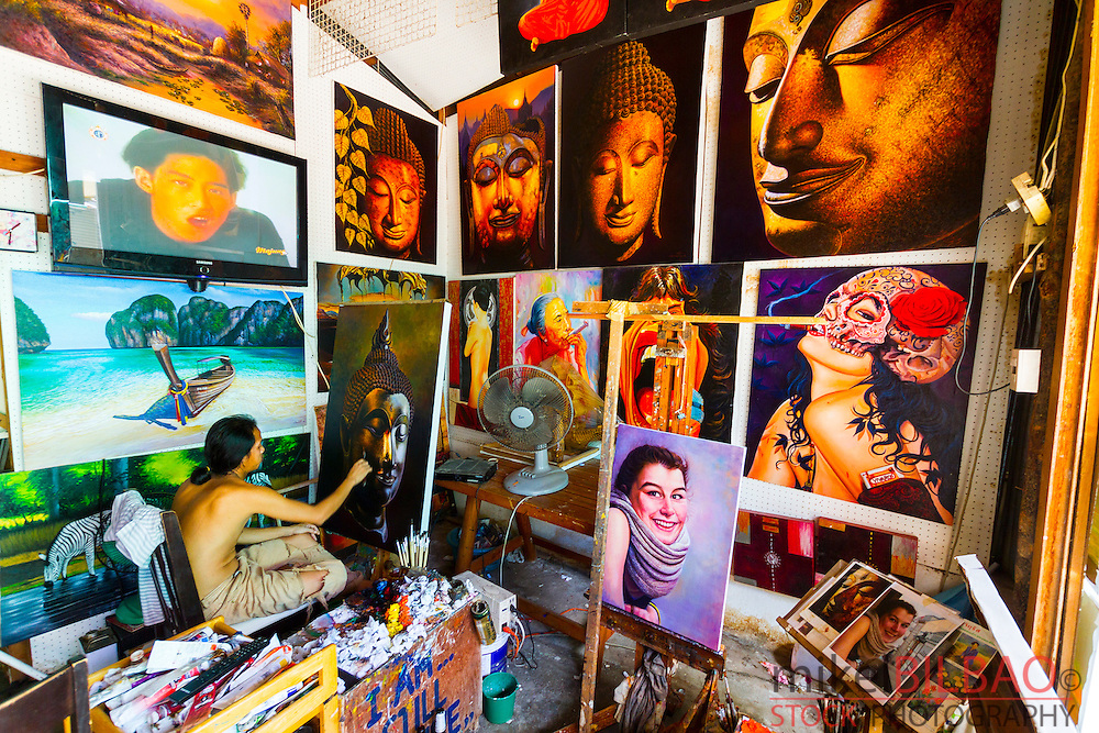 Local painter in his studio. Ton Sai village. Phi Phi Don island. Krabi province, Andaman Sea, Thailand.