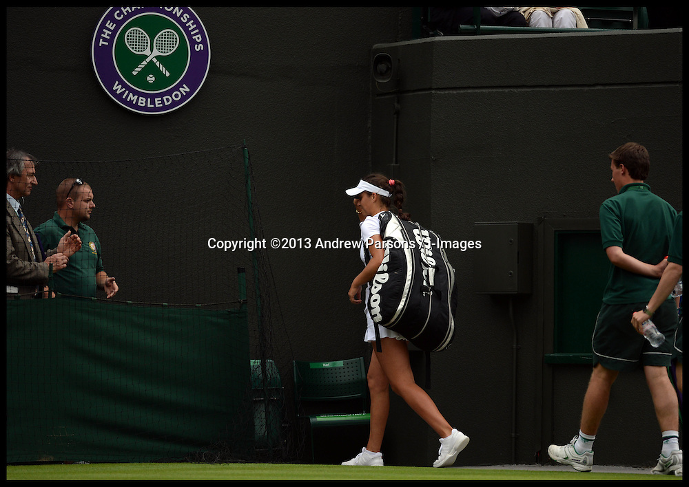 Britain's Laura Robson walks off Court No1 after beating Maria Kirilenko at the Wimbledon Tennis Championships<br /> Tuesday, 25th June 2013<br /> Picture by Andrew Parsons / i-Images