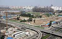 Blick auf das in Bau befindliche Schwimmstadion und Olympia Stadion. © Urs Bucher/EQ Images