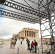Scaffolding surrounds the Parthenon. The ancient Parthenon (circa 400 BC, the largest Doric temple ever built) sits on the Acropolis hill surrounded by global tourists and scaffolding. Here the modern world's philosophy was born. The 29th modern Olympic circus came home to Greece in 2004 and the birthplace of athletics was among the woodland of Ancient Olympia where for 1,100 continuous years, the ancients held their pagan festival of sport and debauchery. The modern games share many characteristics with its ancient counterpart. Corruption, politics and cheating interfered then as it does now and the 2004 Athens Olympiad will echo both what was great and horrid about the past.