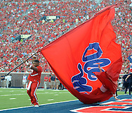 A Mississippi chearleader falls into a giant flag while tumbling vs. Southeast Missouri State at Vaught-Hemingway Stadium in Oxford, Miss. on Saturday, September 7, 2013. (AP Photo/Oxford Eagle, Bruce Newman)