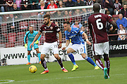 Juanma Dalgado battles Brad McKay during the Ladbrokes Scottish Premiership match between Heart of Midlothian and St Johnstone at Tynecastle Stadium, Gorgie, Scotland on 2 August 2015. Photo by Craig McAllister.