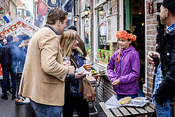 April 27, 2018 - The Hague, The Hague, Netherlands - Small girl seen selling self made cake at street festival on King's Day in city of The Hague in Netherlands. Koningsdag or King's Day is a national holiday in the Kingdom of the Netherlands. Celebrated on 27 April, the date marks the birth of King Willem-Alexander. (Credit Image: © Hendrik Osula/SOPA Images via ZUMA Wire)