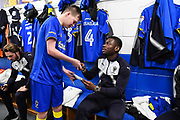 AFC Wimbledon Defender Adedeji Oshilaja (4) meets the match day mascot ahead of the EFL Sky Bet League 1 match between AFC Wimbledon and Fleetwood Town at the Cherry Red Records Stadium, Kingston, England on 30 March 2018. Picture by Stephen Wright.