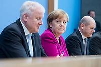 12 MAR 2018, BERLIN/GERMANY:<br /> Horst Seehofer (L), CSU, desig. Bundesinnenminister, Angela Merkel (M), CDU, Bundeskanzlerin, und Olaf Scholz (R), SPD, desig. Bundesfinanzminister, waehrend einer Pressekonferenz zum Koalitionsvertrag der CDU/CSU und SPD, Bundespressekonferenz<br /> IMAGE: 20180312-01-025