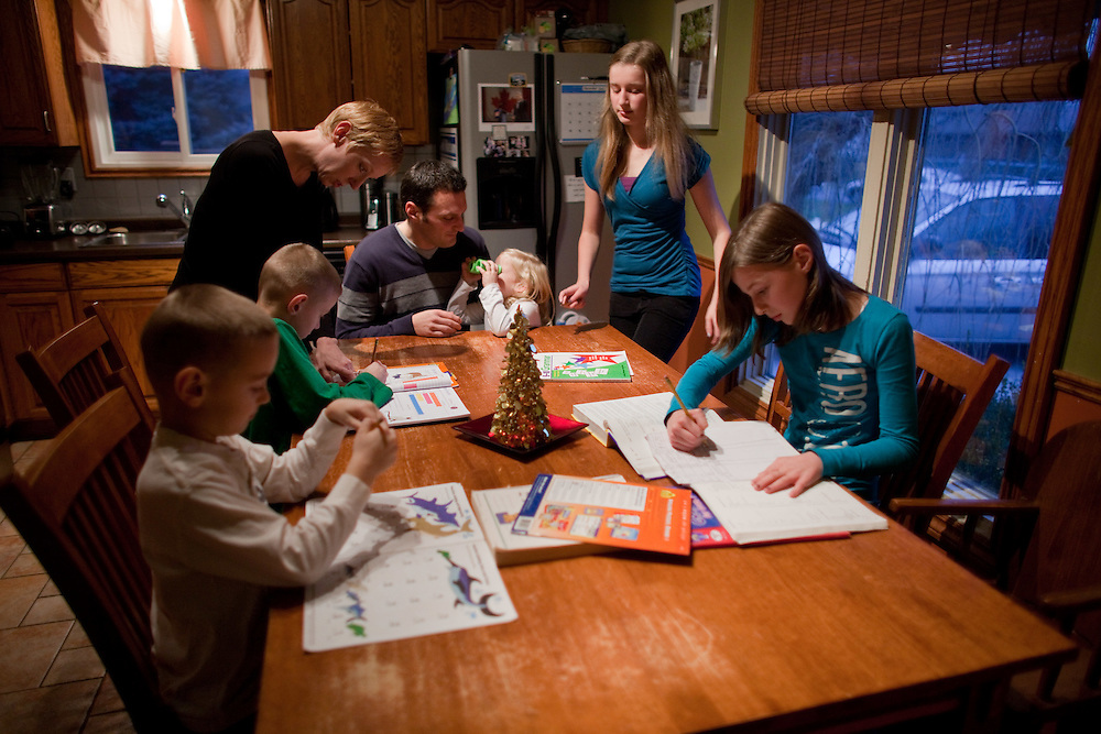 Windsor, Ontario ---11-12-16--- Essex Conservative MP Jeff Watson and his wife Sarah, help their five children with their schoolwork in their Amherstburg, Ontario home December 16, 2011 . Watson advocates for a national adoption strategy, and is working in Parliament for more uniform national policies around adoptive practices and tax supports.<br /> GEOFF ROBINS Toronto Star