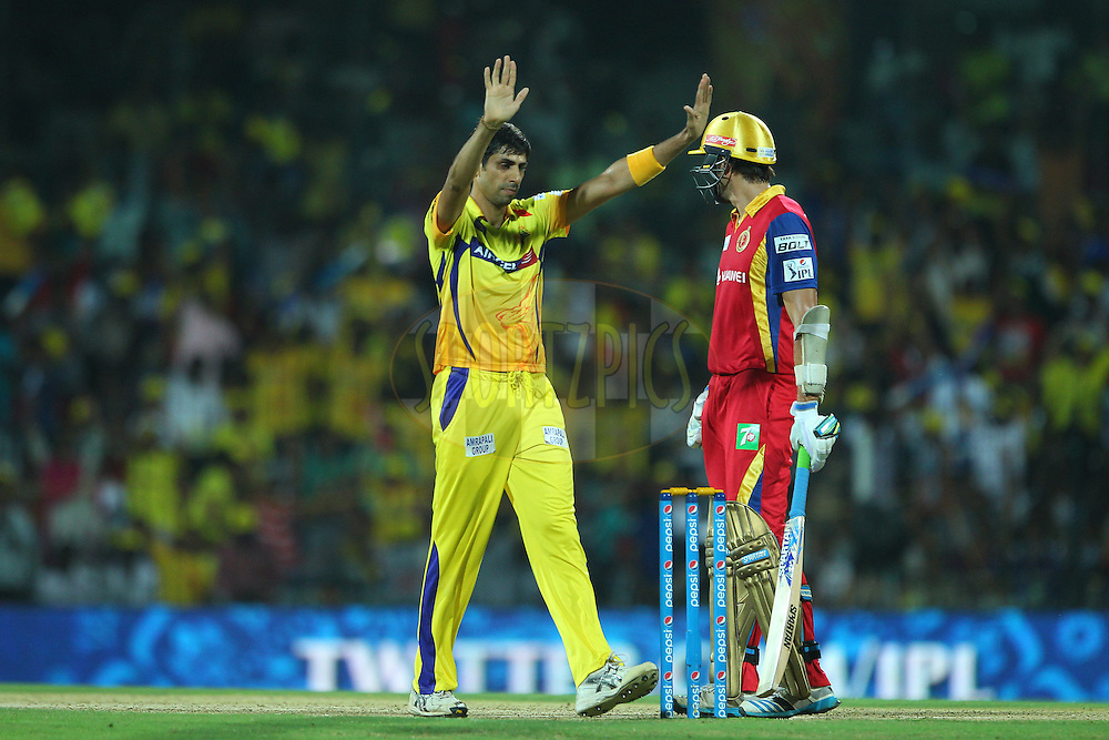 Ashish Nehra of the Chennai Superkings celebrates the wicket of Harshal Patel of the Royal Challengers Bangalore  during match 37 of the Pepsi IPL 2015 (Indian Premier League) between The Chennai Superkings and The Royal Challengers Bangalore held at the M. A. Chidambaram Stadium, Chennai Stadium in Chennai, India on the 4th May April 2015.<br /> <br /> Photo by:  Ron Gaunt / SPORTZPICS / IPL