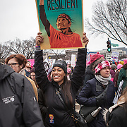 "Tiffany Harris, a DC resident, holds up a sign supporting indigenous rights during the Women's March on Washington where an anticipated 200,000 people turned into an estimated 500,000 to 1 million people, on Saturday, January 21, 2017.  Harris' father is is a mix between Ponca and Puyallup tribes, while her mother is Jewish.  Her grandparents are survivors of the Holocaust.  When asked about her hopes for the next 4 years, Harris said, ""I hope that we're all wary of [President Trump]...we've seen he's a dangerous and divisive man...but he works for us and I hope he takes that seriously.""  She also added, ""...we're very afraid and hope he doesn't undo all the work we've done...""  John Boal Photography"