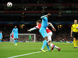 Arsenal's Aaron Ramsey is fouled by Marseille's Nicolas Mkoulou on the edge of the box but a penalty is awarded - Photo mandatory by-line: Joe Meredith/JMP - Tel: Mobile: 07966 386802 26/11/2013 - SPORT - FOOTBALL - Emirates Stadium - London - Arsenal V Marseille - Champions League - Group F