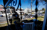 Viewed through a storm door, people make their way to a house party in Manchester, N.H.,  Saturday, May 2, 2015, that Presidential hopeful Sen. Bernie Sanders is going to attend.  Sanders discussed important economic issues facing the country and took questions during his visit. (AP Photo/Cheryl Senter)