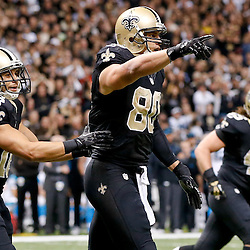 Dec 8, 2013; New Orleans, LA, USA; New Orleans Saints tight end Jimmy Graham (80) celebrates after a touchdown against the Carolina Panthers during the fourth quarter of a game at Mercedes-Benz Superdome. Mandatory Credit: Derick E. Hingle-USA TODAY Sports