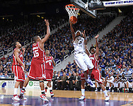 Kansas State forward Cartier Martin (20) scores between Oklahoma defenders Nate Carter (24) and David Godbold (15), during second half action at Bramlage Coliseum in Manhattan, Kansas, March 3, 2007.  K-State beat Oklahoma 72-61.