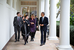 President Barack Obama walks on the Colonnade with, from left, Press Secretary Josh Earnest, Cecilia Muñoz, Domestic Policy Council Director, Senior Advisor Valerie Jarrett and Jennifer Palmieri, Director of Communications, following a press conference in the East Room of the White House, Nov. 5, 2014. (Official White House Photo by Pete Souza)<br /> <br /> This official White House photograph is being made available only for publication by news organizations and/or for personal use printing by the subject(s) of the photograph. The photograph may not be manipulated in any way and may not be used in commercial or political materials, advertisements, emails, products, promotions that in any way suggests approval or endorsement of the President, the First Family, or the White House.