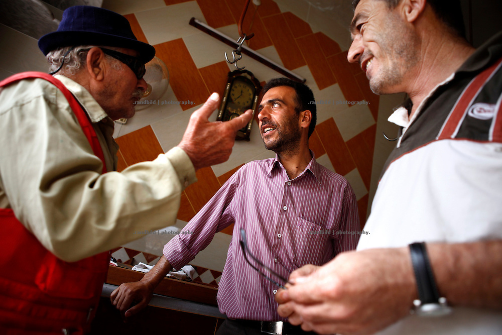 Some men chatting in a butchery in Koreen.<br />