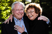 Russ and Janel Davis pose for a belated 25th anniversary portrait outside their home in Holland, Mich., during autumn on Oct. 9, 2005.