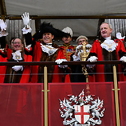 Alderman William Russell waving the hat will Feltmakes and Band from Switzerland passing by at Lord Mayor's Show assembly at M Restaurant on 9 November 2019, London, UK. Credit to Picture Capital