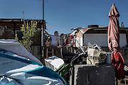 Famiglia rom segue l'intervento di Matteo Salvini all'interno del campo del quartiere periferico di Tor Sapienza. Roma 24 Febbraio 2016. Christian Mantuano / OneShot