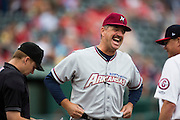 Manager Brian Poldberg (27) of the Northwest Arkansas Naturals laughs during the pregame meeting prior to a game against the Springfield Cardinals at Hammons Field on July 28, 2013 in Springfield, Missouri. (David Welker)