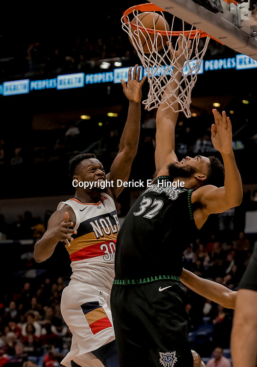 Dec 31, 2018; New Orleans, LA, USA; New Orleans Pelicans forward Julius Randle (30) shoots over Minnesota Timberwolves center Karl-Anthony Towns (32) during the second half at the Smoothie King Center. Mandatory Credit: Derick E. Hingle-USA TODAY Sports