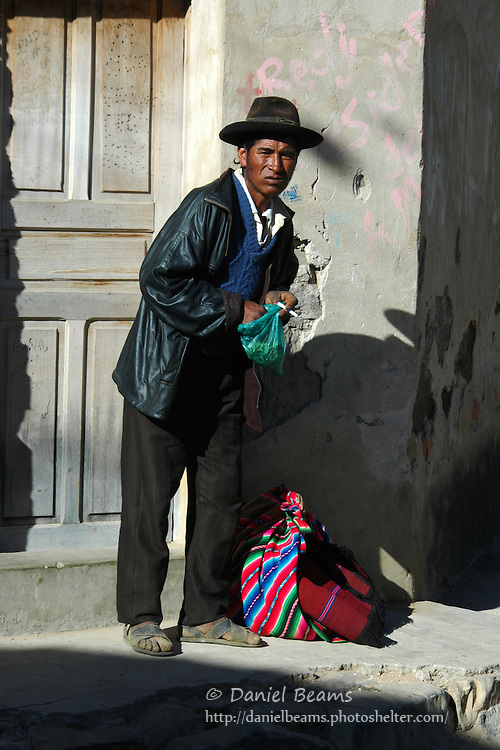 Campesino man chewing coca leaves in the Tarabuco market, Chuquisaca, Bolivia