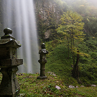 "Dangyo-no-taki Waterfalls is known for its sacred ""winning"" water which sumo wrestlers or owners of bull sumos would bathe in before competitions. The male waterfall (pictured) flows next to a beautiful shrine. Dangyo Falls is located on Dogo, the largest island of the Oki Islands which is an archipelago in the Sea of Japan, Shimane Prefecture, Japan."