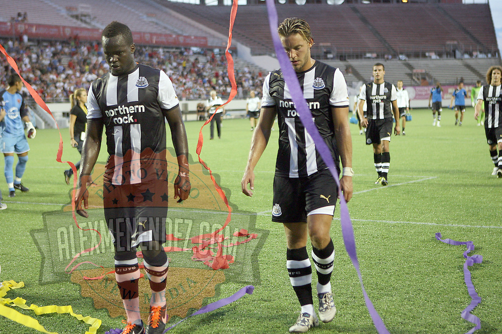 Newcastle players leave the pitch during an International Friendly soccer match between English Premier League team Newcastle United and the Orlando City Lions of the United Soccer League, at the Florida Citrus Bowl on Saturday, July 23, 2011 in Orlando, Florida. Orlando won the match 1-0. (AP Photo/Alex Menendez)