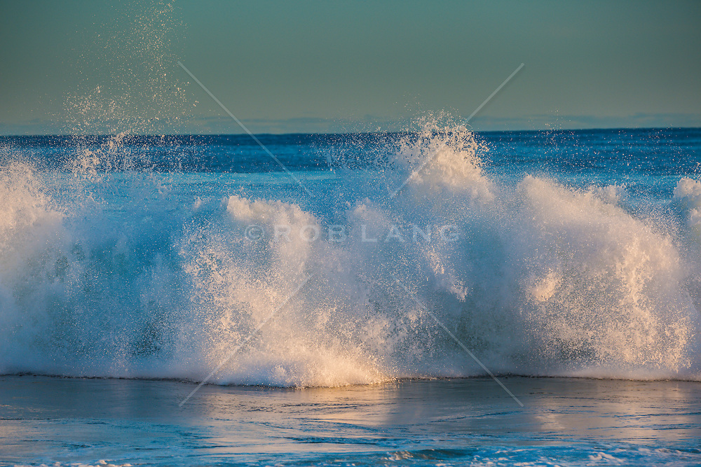 morning light on waves at the beach in East Hampton, NY