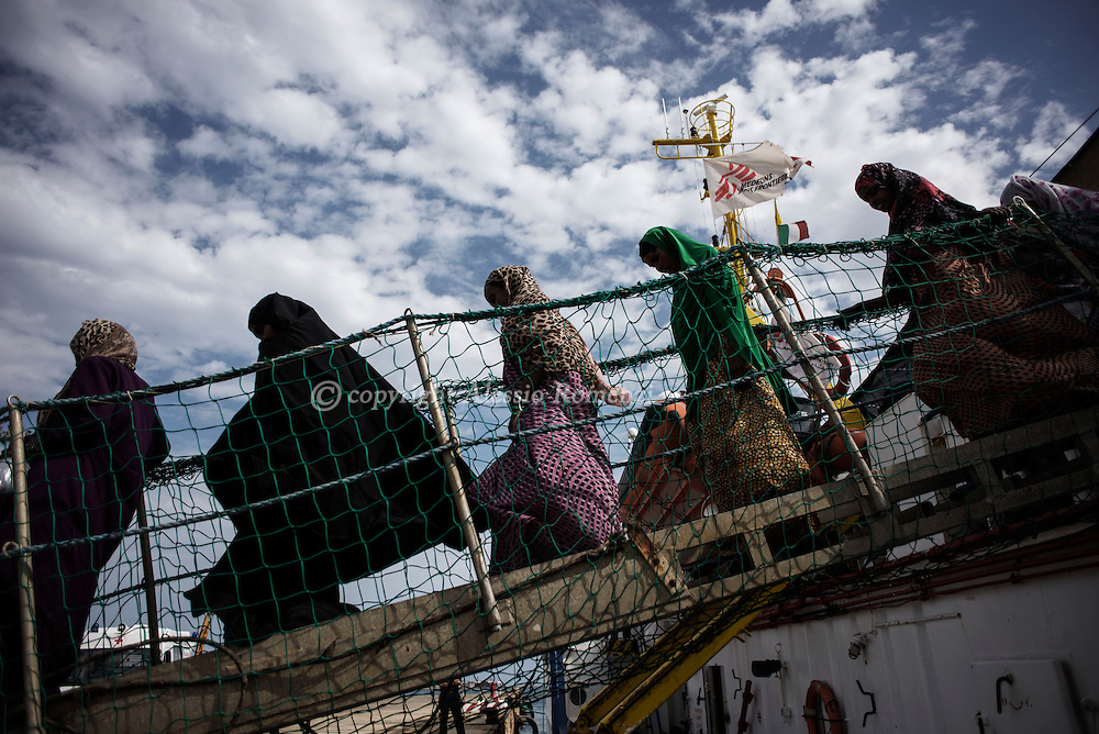 Italy: MSF Dignity1: migrants rescued at sea get of the MSF ship Dignity1 on the deck of the Augusta port on August 25, 2015. Alessio Romenzi