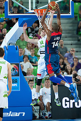 Zoran Dragic of Slovenia and Alexis Ajinca of France during friendly match between National teams of Slovenia and France for Eurobasket 2013 on August 31, 2013 in Arena Stozice, Ljubljana, Slovenia. (Photo by Matic Klansek Velej / Sportida.com)
