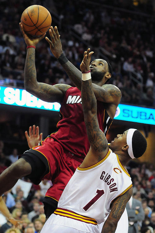 March 29, 2010; Cleveland, OH, USA; Miami Heat small forward LeBron James (6) shoots over Cleveland Cavaliers point guard Daniel Gibson (1) during the third quarter at Quicken Loans Arena. The Cavaliers beat the Heat 102-90. Mandatory Credit: Jason Miller-US PRESSWIRE