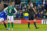 Referee Craig Thomson points at Vykintas Slivka (#8) of Hibernian FC before booking him during the Ladbrokes Scottish Premiership match between Hibernian and Rangers at Easter Road, Edinburgh, Scotland on 19 December 2018.