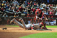 Apr. 10 2011; Phoenix, AZ, USA; Cincinnati Reds second basemen Brandon Phillips (4) slides into home plate during the second inning against the Arizona Diamondbacks catcher Henry Blanco (12) at Chase Field. Mandatory Credit: Jennifer Stewart-US PRESSWIRE..