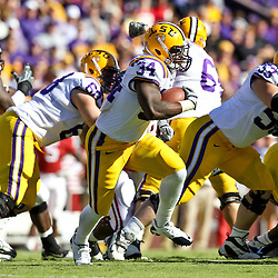 November 6, 2010; Baton Rouge, LA, USA; LSU Tigers running back Stevan Ridley (34) runs against the Alabama Crimson Tide during the first half at Tiger Stadium.  Mandatory Credit: Derick E. Hingle