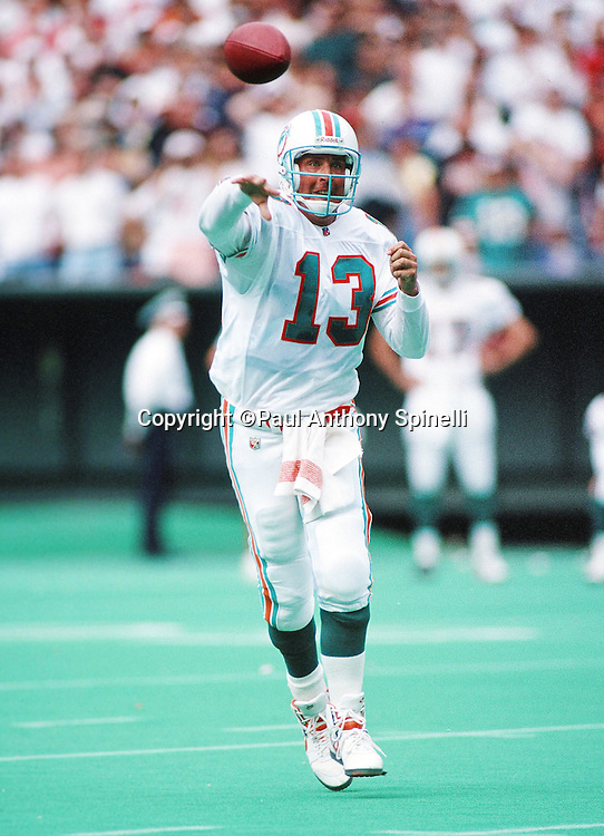 Miami Dolphins quarterback Dan Marino (13) throws a pass during the NFL football game against the Cincinnati Bengals on Oct. 1, 1995 in Cincinnati. The Dolphins won the game 26-23. (©Paul Anthony Spinelli)