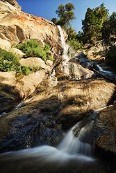 Though the name would suggest otherwise, this image of a quite docile Grizzly Falls was calmed by the late summer's dry season. It's name derives from the spring torrent that washes over it's rocky face from the winter's snowmelt. Grizzly Creek is one of the many cascades that connects to the Kings River, which has carved out the deepest canyon in North America, the Kings Canyon.