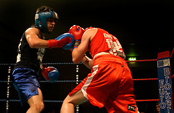 UK ENGLAND LONDON 2DEC04 - Boxer Sezer Yurtseven (blue shirt) trades punches with 'Mad' Michael Stevens during their fight at the London Mariott Hotel, Mayfair. The high-adrenaline contact sport of White Collar Boxing originated in New York 17 years ago and attracts mostly young males from the financial, legal and medical professions.....jre/Photo by Jiri Rezac ....© Jiri Rezac 2004....Contact: +44 (0) 7050 110 417..Mobile:  +44 (0) 7801 337 683..Office:  +44 (0) 20 8968 9635....Email:   jiri@jirirezac.com..Web:    www.jirirezac.com....© All images Jiri Rezac 2004 - All rights reserved.
