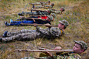 Youngsters participating to the ultra-nationalistic Azovets children's camp are holding a combat position with a wooden rifle, during tactical training on the banks of the Dnieper river, in Kiev, Ukraine's capital.