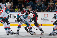 KELOWNA, CANADA - JANUARY 18: Brett Howden #21 of the Moose Jaw Warriors back checks Calvin Thurkauf #27 of the Kelowna Rockets after the face off on January 18, 2017 at Prospera Place in Kelowna, British Columbia, Canada.  (Photo by Marissa Baecker/Shoot the Breeze)  *** Local Caption ***