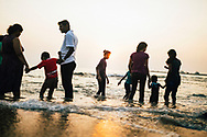 Families wading in the ocean, Galle Face Green, Colombo, Sri Lanka, Asia